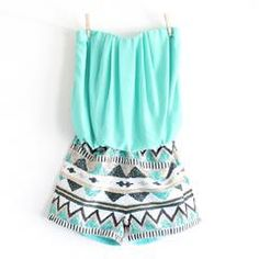 This gorgeous romper features a mint toned soft chiffon like top, gathered waist for the perfect fit, and an aztec print sequin shorts. fully lined. Sweetheart strapless bust. 100% polyester Imported