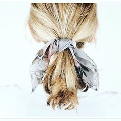 Tie a scarf onto your ponytail.