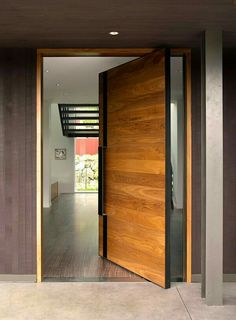 Pivot door with metal pull