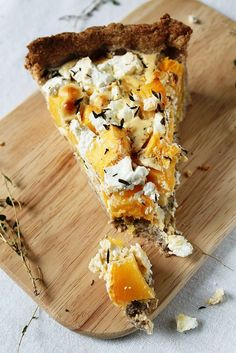 Interesing.....Pumpkin & Feta Tart  adapted from What's For Lunch Honey?    1 1/4 cup (150 g) whole wheat flour  1/3 cup (80 g) soft butter  pinch of salt  1/4 cup (50 ml) milk  1,8 lb (800 g) pumpkin (or squash), cut into bite-size slices  1Tbsp (30 g) sour cream  1/2 cup (100 ml) Creme Fraiche  4 eggs  10 oz (300 g) feat cheese  1/2 Tbsp salt  1/4 tsp pepper  1/2 Tbsp nutmeg  thyme (dried or fresh)