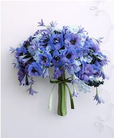 Periwinkle poppies or anemones. Love the spilling over look and the vibrancy of this color. #blue #bouquet (from martha stewart weddings_