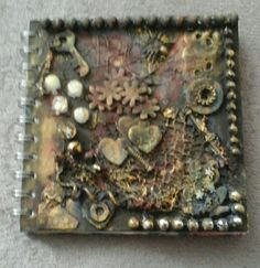 Steampunk notebook. Made by Troll hart.  Produced by scrap and pearls.