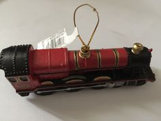 """Universal Studios The Wizarding World of Harry Potter Hogwarts Express Resin Ornament measures app. 4"""" x 1 1/4"""" New with Tags                                                                                                                                                                                 More"""