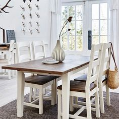 Handcrafted using reclaimed wood. Solid wooden dining room furniture with matching white painted dining chairs. Rustic Wooden Table, Reclaimed Wood Dining Table, Reclaimed Wood Furniture, Wooden Dining Tables, Extendable Dining Table, Wood Table, Painted Dining Chairs, High Back Dining Chairs, Dining Furniture