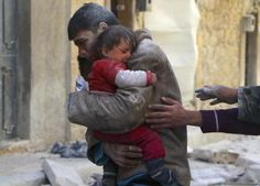 A boy holds his baby sister saved from under rubble, who survived what activists say was an airstrike by forces loyal to Syrian President Bashar al-Assad in Masaken Hanano in Aleppo February 14, 2014.  REUTERS/Hosam Katan