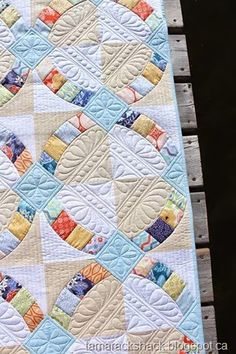 """Quilting by Kathy at Tamarack Shack:  """"This past week I have enjoyed custom quilting my Metro Hoops quilt that I pieced back in January.    This pattern is by Jenny Pedigo of Sew Kind of Wonderful using her Quick Curved Ruler."""""""