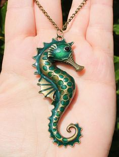 SEAHORSE WITH CHAIN PENDANT. TOTAL PENDANT SIZE: 74 X 35 X 5-6 MM. MATERIAL: OTHER METAL BRONZE COLOR TOTAL CHAIN LENGTH: 55-62 CM. MESH 3 MM APPROXIMATELY. QUANTITY: 1 KASSCLAUDE SHOP SALE GEMSTONE BEADS, CERAMIC, GLASS BEADS, BEADS ACRYLIC, SIZE, COLOR AND DIFFERENT SHAPE. SALE