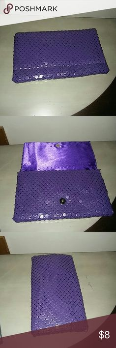 Purple Mesh clutch NWOT Purple mesh clutch new with detachable chain.11wide x 7 long Bags Clutches & Wristlets