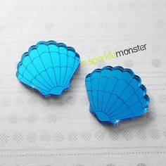 This listing is for a pair of clam shells made out of beautiful blue mirror laser cut acrylic.  Perfect for making mermaid treasure or embellishing some undersea jewelry!  - each measures approx. 1 wide - you will receive 2 pieces of item shown   ♥ Ahoy! Enjoy FLAT RATE SHIPPING no matter how much you order! ♥