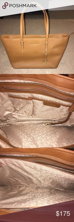 Michael Kors jetset brown leather purse Michael Kors jetset brown leather purse with special padded pocket for laptop. Very lightly used - next to brand new. Michael Kors Bags Shoulder Bags