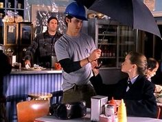 "And adorably shielded her from the rain when Luke's was under construction. | 36 Times Jess Mariano Completely Melted Your Heart On ""Gilmore Girls"""