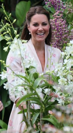 Catherine, Duchess of Cambridge smiles as she views an orchid named in honour of Diana, Princess of Wales at Singapore Botanical Gardens on day 1 of their Diamond Jubilee tour on September 11, 2012 in Singapore.