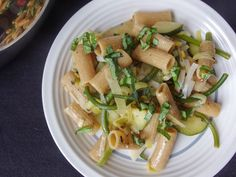 One pot pasta with zucchini, garlic scapes and leeks in white wine lemon sauce. Everything cooks at the same time in one pot. Vegan recipe.
