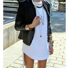 White tunic and black, leather jacket