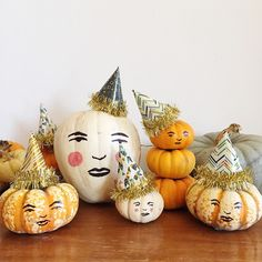 Pumpkins with hand drawn faces and party hats.  Fun for Thanksgiving or you could make the faces scarier for Halloween, too.