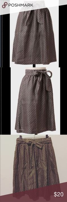 Polka Dot Chambray Skirt Delightful knee-length chambray skirt with dots and removable matching sash belt. See first two photos for true color (from ShopRuche). Skirt is a gray-taupe color. Natural waist and A-line skirt. Fabric does not provide stretch. ShopRuche Skirts