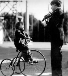 Charlie Chaplin playing his violin for little Jackie Coogan. In the scene where the authorities come to take the boy away from him instead of the tramps hair being wild and curly it was sort of flat...
