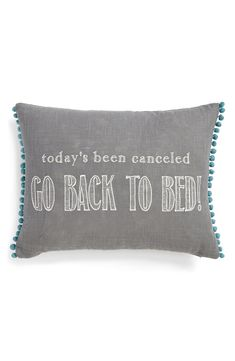 Today's been cancelled. Go back to bed! Love this cute pillow complete with colorful pompoms.