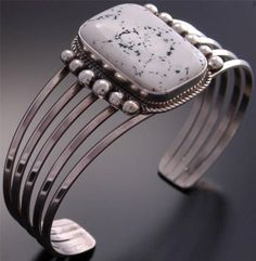 Fabulous White Buffalo Silver Bracelet by Boyd - Navajo Handmade  | Such a gorgeous balance to the white buffalo turquoise that sits at the center of this 5 - prong bracelet.