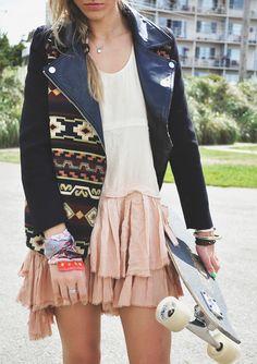 Layered blush skirt. Aztec print panelled, black, leather jacket. Skateboard. Girl street style.