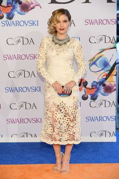 Sophia Bush looks super fierce and feminine as she attends the 2014 CFDA Fashion Awards held at Alice Tully Hall on June 2th, 2014. Dress by Marchesa.