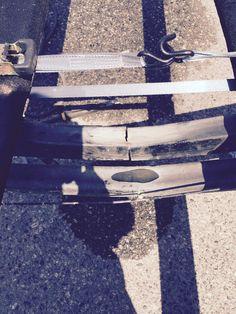 Cracked boat frame before welding repairs.