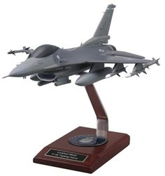 Highly detailed F-16 Viper model with customized base, tail number, data plate and optional patch. No detail is spared: antennas, pitot tubes, individualized base, name under the canopy rail, squadron tail flash and specific aircraft tail number! Air to Air and Air to Ground Configurations are available.  www.AimHigherJets.com