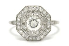 The Ogden Art Deco diamond filigree engagement ring has a mesmerizing Greek key platinum pierced design and a sleek octagon halo. Centering on a 3/4 carat blazingly brilliant transitional round diamond held securely in a low-to-your-hand bezel setting orbited by 2 rows of sparkling old cut diamonds. #diamond #platinum #engagementring #cocktailring #cocktailrings #diamonds #haloring #halorings #octagon #octagonring #octagonrings #heirloom #estatejewelry #estatejewelery #filigree #jewelry Estate Engagement Ring, Filigree Engagement Ring, Antique Engagement Rings, Estate Jewelery, Greek Key, Art Deco Diamond, 1 Carat, Diamond Bands, Round Diamonds