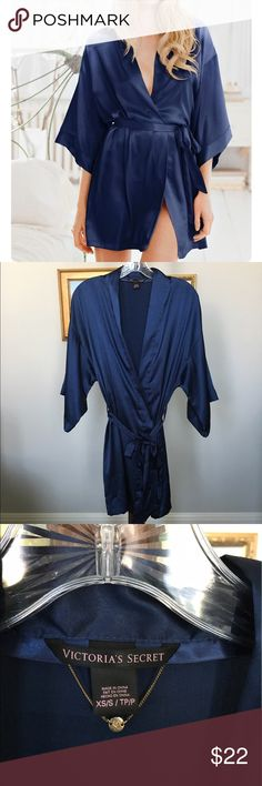 """NWOT VS Navy Satin Kimono Wrap size XS/S Brand new Victoria's Secret navy satin short kimono wrap size XS/S. I actually won this at a store opening on a trip to Vancouver, B.C.! It's great, but I never wore it because I'm a robe junkie and already have tons ❤️ The color is absolutely gorgeous, and it's got an inside tie and also pockets!  Bust approximately 44"""" (but it's adjustable), length 34"""". Victoria's Secret Intimates & Sleepwear Robes"""