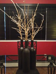Black painted wine bottles with gold painted branches