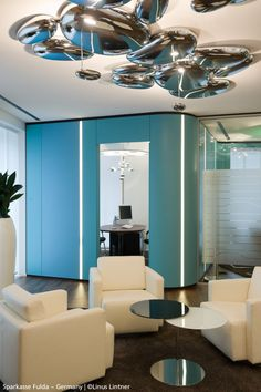 #Skydro ceiling, #design Ross Lovegrove And in the background the #Mercury suspension, also designed by Ross Lovegrove.