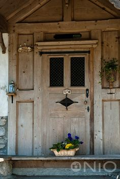 A chapel door decorated in Swiss alpine style.
