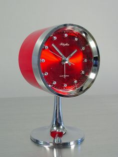Alarm Clock Table Clock with Tulip Base by Rhythm. Mod Chrome and Red Atomic Space Age Alarm… Wood Grain LED Alarm Clock Vintage Alarm Clocks, Retro Clock, Unique Clocks, Cool Clocks, Mid Century Modern Table, Atomic Age, Desk Clock, Space Age, Retro Futurism