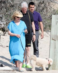 Group outing: The political pair were accompanied by a Secret Service agent and their dogs...