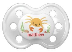 Cute, personalized pacifier featuring a little, yellow kawaii style cartoon crab. Customizable name. Would make a cute gift for an under the sea themed baby shower.