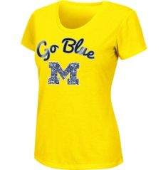 Root for your favorite Wolverines in style this season in the Colosseum Athletics® Women's Michigan Wolverines Bling Scoop Neck T-Shirt. This spirited tee screams school pride with its team logo and wordmark screen-printed on the front. The clear sequins over the team logo add some fun and feminine flair to your Maize and Blue wardrobe. The tagless ribbed collar provides ultimate comfort so you can cheer your team at ease.