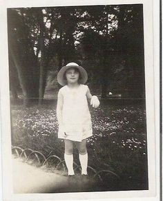 Antique 1920 1930 french black and white photography little girl wearring white dress and hat.  via Etsy.