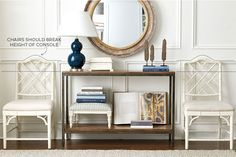 Chairs flanking the console table should break the height of the table