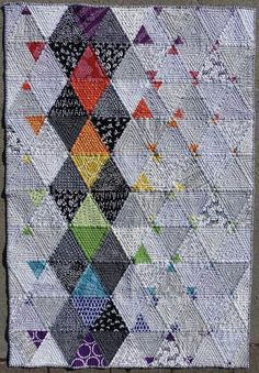 Interesting quilt based on triangle shapes in different sizes & colors