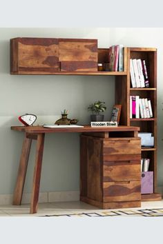 A storehouse and a dedicated spot for your work! The Grande Study Table is suave and efficient with three drawers, one cabinet, and four open shelves that can hold your stationery as well as souvenirs, crafted from Sheesham wood and available in different finish options viz., teak, walnut, and honey. #studytable #moderndesign #furniture #workfromhome #homeoffice