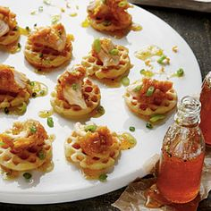 Buttermilk Chicken and Waffles - 14 Festive Mini Appetizers - Southernliving. Keep waffles warm in a oven up to 30 minutes before assembling. Top waffles with chicken, and drizzle with Peach-Horseradish Maple Syrup. Recipe: Buttermilk Chicken and Waffles Mini Appetizers, Wedding Appetizers, Appetizer Recipes, Chicken Appetizers, Party Recipes, Shower Appetizers, Southern Appetizers, Chicken Recipes, Appetizer Ideas