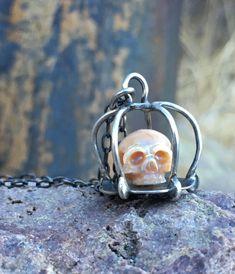 8bc3790770855b www.arloedgewalker.com carved pearl skull in sterling silver cage
