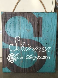 Family established sign on salvaged wood