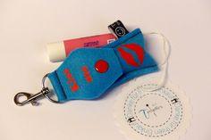Ein nettes Accessoires für die Handtasche zum Verschenken oder selber Schenken.  Trendies-LaBell-Taschi inkl. Balsamstift.