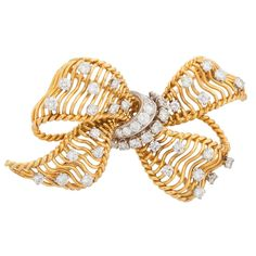 Bulgari Diamond Gold Bow Brooch | From a unique collection of vintage brooches at https://www.1stdibs.com/jewelry/brooches/brooches/