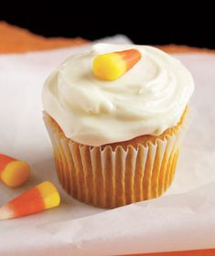 Pumpkin Cupcakes with Cream Cheese Frosting - Easy Halloween Party Recipes on RealSimple.com