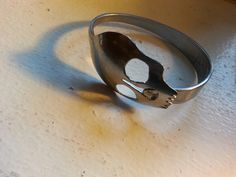Originator of the hand made skull spoon bracelet. Www. Quarterrings.com contact me for custom jewelry. Michael Briehler