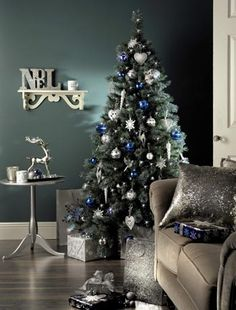 I like this tree, and we do have a gray sofa. But everything else in our place is shades of brown, green and whatever. No a speck of blue. .hope our blue tree looks good anyhow.