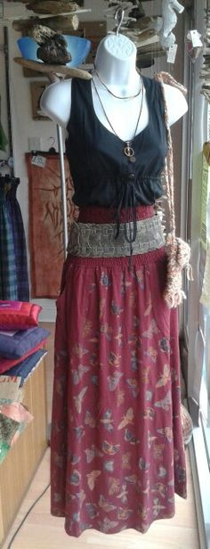 Pocket top tucked in £14.00 Butterfly skirt/dress £27.00 Leather belt £12.00 Knitted bag £4.00 Wrap necklace £2.50 Dreamcatcher necklace £5.00