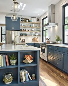 Love the style of this house. Clean but with pops of color. No open shelving in kitchen though.